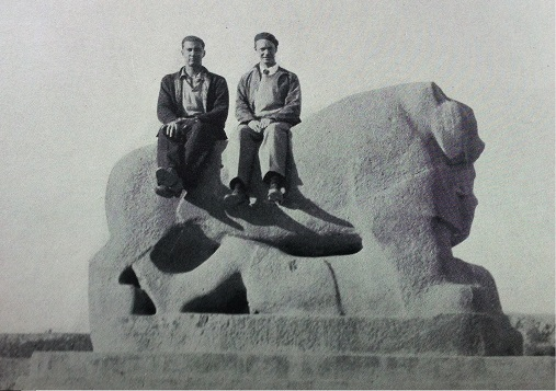 Richard Halliburton and Stephen Moye sitting on statues at Babylon. I think that's frowned upon these days.