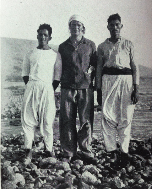 Richard Halliburton with two fishermen before swimming across the Sea of Galilee