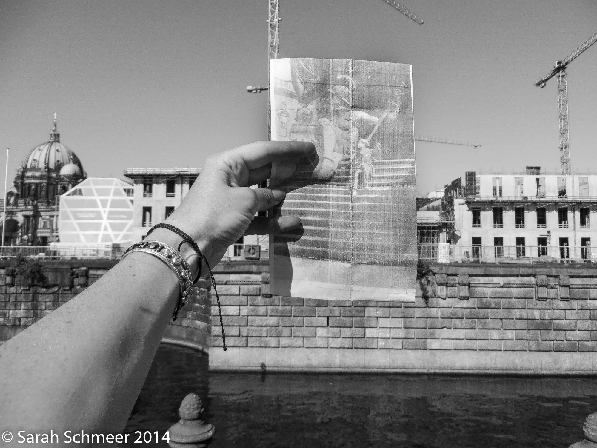 Richard's photo held against a backdrop of construction where the National Monument to Kaiser Wilhelm used to stand.