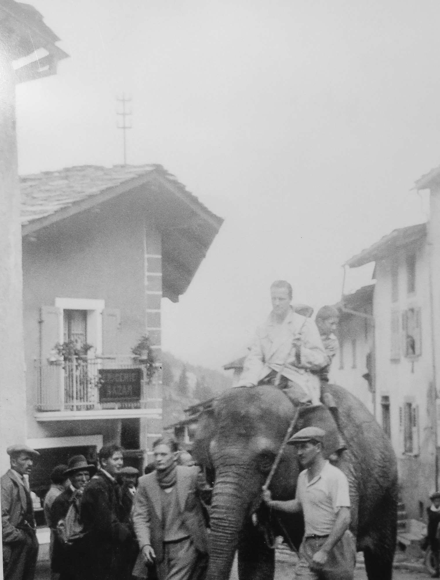Photo of Richard riding Elysabethe Dalrymple through a town in 1935.  This photo is posted on a display at Great Saint Bernard Pass--they remember Richard!