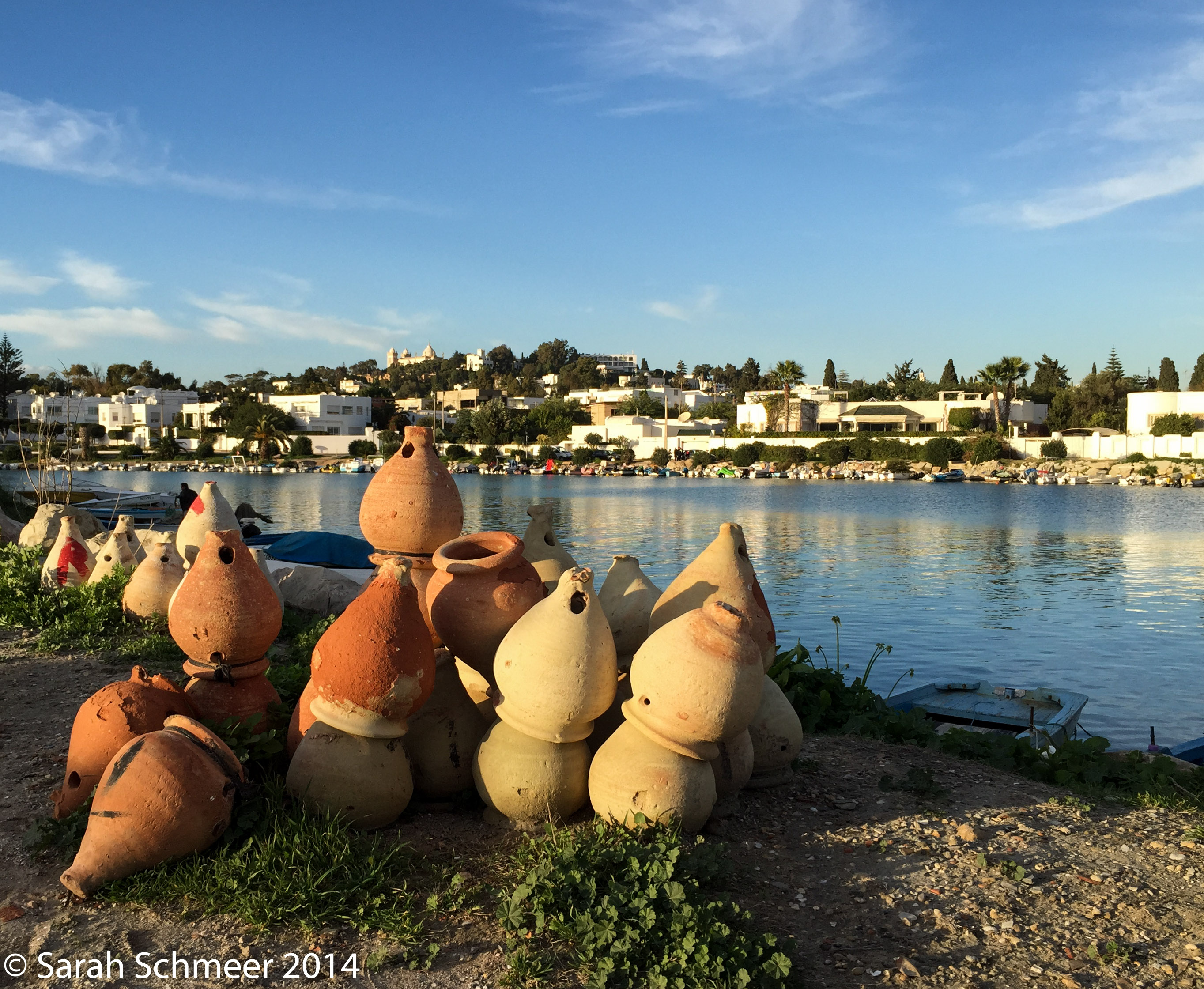 Clay pots for catching octopi with the city of Carthage in the background.