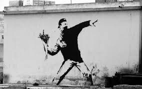 """Man Throwing Flowers"" by Banksy in Bethlehem (photo credit: kulturawplot.pl)"